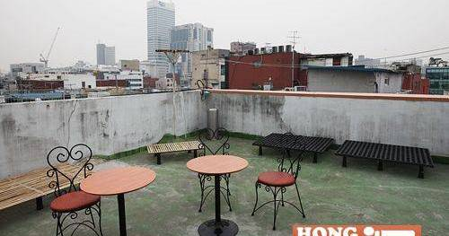 Make cheap reservations at a hostel like Hong Guesthouse Downtown