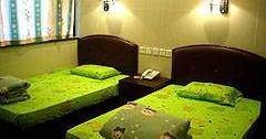 Make cheap reservations at a hostel like Tai Wan Hotel